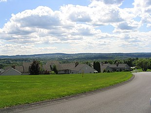 """A neighborhood in the hills of the town of Manlius outside the <a href=""""http://search.lycos.com/web/?_z=0&q=%22Manlius%20%28village%29%2C%20New%20York%22"""">village of Manlius</a>"""