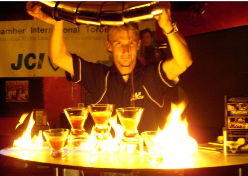 File:How to pour 5 martinis at the same time while on fire.jpg