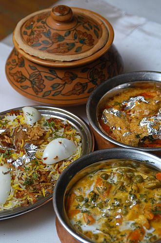 Hyderabadi biryani along with other Hyderabadi cuisine Hyderabadi biryani (406687573).jpg