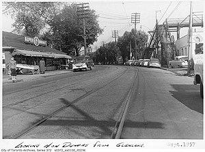 IGA (supermarkets) - IGA store (left) on Dundas Street in Toronto, September 1957.