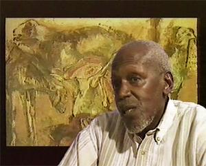 """Iba N'Diaye - Iba N'Diaye seated in front of one the """"Tabaski"""" series, (1995)"""