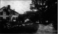 Ida Tarbell House with outbuildings, stone wall, driveway.png