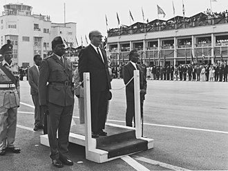 Idi Amin - Amin (centre-left) as chief of staff during a visit of Israeli Prime Minister Levi Eshkol (centre) in 1966