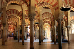 """The arches of red-and-white stripes inside the """"La Mezquita"""" in Córdoba, Spain represent some of the pinnacles of the Moorish architectures."""