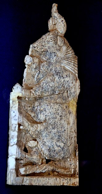 Nimrud ivories - Ivory plaque from Nimrud. It depicts a standing and striding bull. From Nimrud, Mesopotamia, Iraq. Neo Assyrian Period, 911 to 612 BCE. Erbil Civilization Museum, Iraq