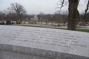Inauguration of John F. Kennedy - The most famous passage from the inaugural address is etched in stone at Kennedy's gravesite in Arlington National Cemetery, with the Lincoln Memorial and Washington Monument in the background.