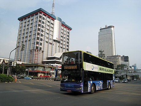 Jakarta doubledecker tourists bus passing in front of Sarinah Thamrin building, Central Jakarta Jakarta Doubledecker Tourist Bus at Sarinah Thamrin.jpg