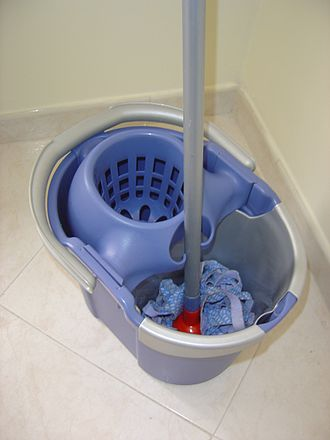 Mop - A mop in a bucket with its dryer