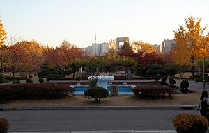 Jeongdok Public Library - Exiting front entrance, N Seoul Tower and Jongno Tower in distance, 2014.