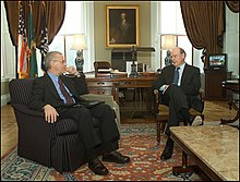 Chernow (left) with John W. Snow in 2004