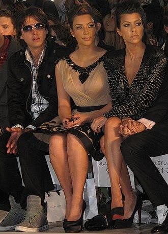 Jonathan Cheban - Cheban (left) with Kim and Kourtney Kardashian in 2010
