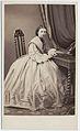 Kabinettkort. Porträtt, helfigur, av kvinna. Hon är iförd klänning med vid kjol och vida ärmar - Nordiska Museet - NMA.0053184.jpg