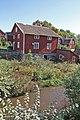 Kvarnbyggnaden med ån i förgrunden, Focksta kvarn, Hagby socken, Uppland.jpg