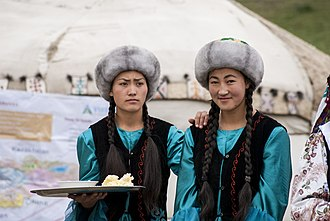 Kyrgyz people - Kyrgyz women offering butter and salt