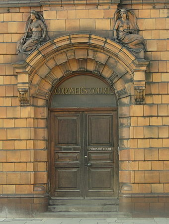 The entrance to the Coroner's Court. Above the doorway to the left is Lady Justice. The mirror held by the woman on the right represents truth. LRF Coroner's court entrance.jpg
