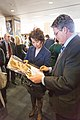 Labor Secretary Elaine Chao and Ted Kennedy Jr. sign posters, 2015.jpg