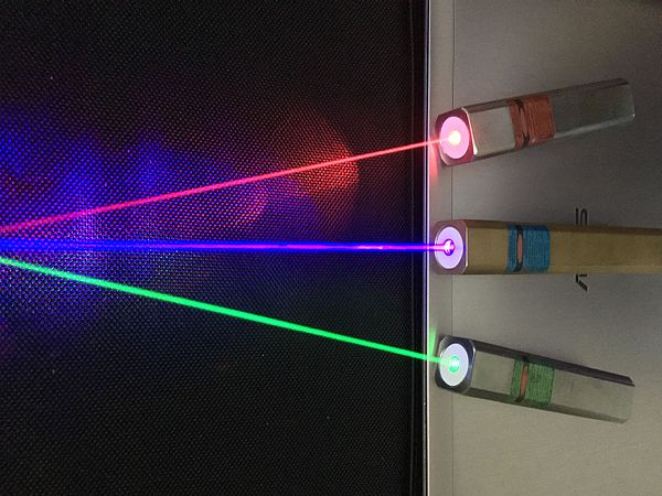 Red (635 nm), blueish violet (445 nm), and green (520 nm) laser pointers Laser Pointers.jpg