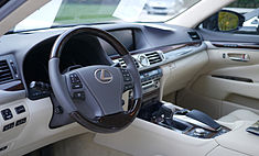 View of a forward car interior with steering wheel