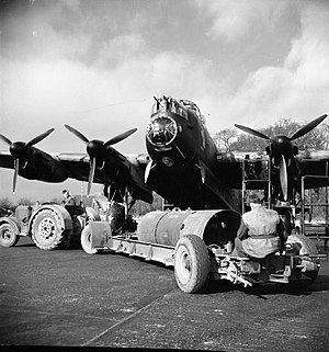 No. 106 Squadron RAF - An 8,000-lb HC bomb ('super cookie') is brought to an Avro Lancaster of 106 Squadron at RAF Syerston, for an attack on  Stuttgart
