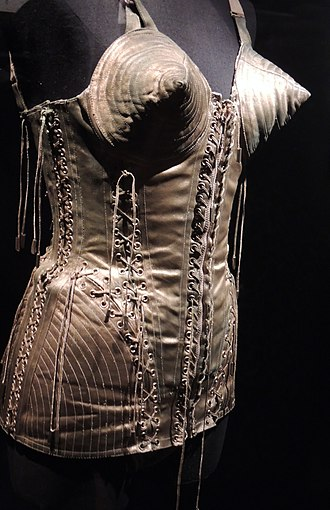 Cultural impact of Madonna - Iconic corset made by fashion designer Jean Paul Gaultier that Madonna wore during her 1990 Blond Ambition World Tour. Is one of the most famous designs in fashion industry.
