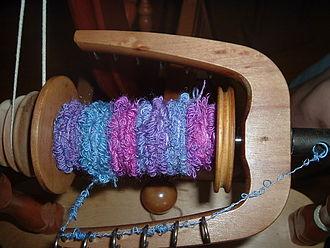 Bouclé - Bouclé in the process of being spun