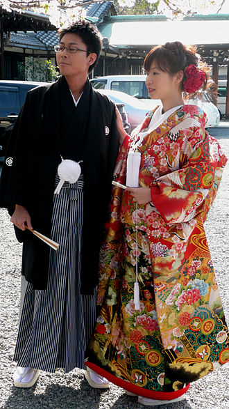 Japanese clothing - Photograph of a man and lady wearing traditional clothing, taken in Osaka, Japan.