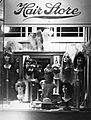 Mardi Gras wigs and costume jewelry in store window in New Orleans Louisiana in 1940s.jpg