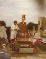 Marie Atmadjian next to family grave.png