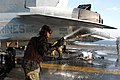 Marines wash the surface of an F-A-18C Hornet (5559327652).jpg