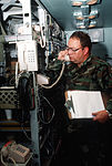 Master Sgt. Rock Boardman of the 143rd Combat Communications Squadron, Washington Air National Guard, tests a telephone circuit in a TCS-62 technical control shelter during the NATO Exercise Tactical Fighter DF-ST-90-10851.jpg