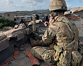 Member of 45 Commando Royal Marines manning a General Purpose Machine Gun on a rooftop MOD 45159130.jpg