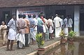 Men standing in queue to cast votes in Kerala State Assembly Elections in Kuttanadu, Kerala on April 22, 2006.jpg