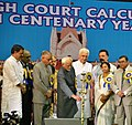 Mohd. Hamid Ansari lighting the lamp to inaugurate the Sesqui centenary celebrations of Calcutta High Court in Kolkata. The Governor of West Bengal, Shri M.K. Narayanan.jpg