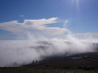 Parc naturel régional d'Armorique - View over Monts d'Arrée in Brittany from Mont Saint-Michel de Brasparts. While it is sunny at the Mont, it is foggy at Elez Yeun