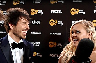 Kelsea Ballerini - Morgan Evans and Kelsea Ballerini during a Planet Country interview on the CMC Awards red carpet in March 2016 around the time their relationship started.