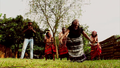 Ms musinguzi and her dancers.png
