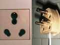 Multi-standard Type-D and M socket, and a Type-D plug.png
