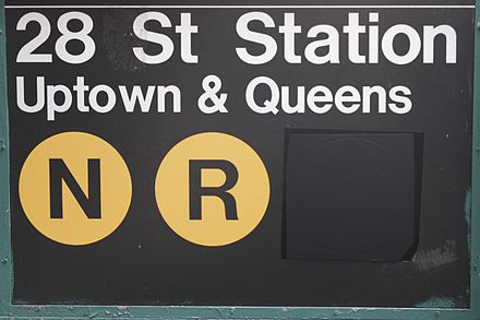 28th Street station after the W train was discontinued in mid-2010. Note the dark grey tape masked over the W bullet. (This sign has since been replaced due to the restoration of the W in 2016.) NYC MTA no W.jpg