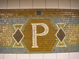 34th Street–Penn Station (IRT Broadway–Seventh Avenue Line) - Trim line tablets
