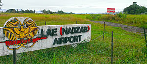 Nadzab - Photo of Nadzab airport sign. Village in background