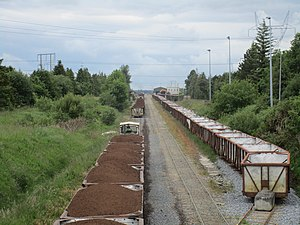 Bord na Móna - Clonmacnoise and West Offaly Railway: A succession of trains (here three are visible) bring milled peat to the Shannonbridge electricity generating station.