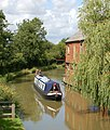 Narrowboat approaching bridge 66, Oxford Canal - geograph.org.uk - 1414755.jpg