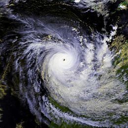 Satellite image of a powerful cyclone near the coast of Western Australia. The storm is very mature, with a large area of deep thunderstorms and a well-defined, clear eye.
