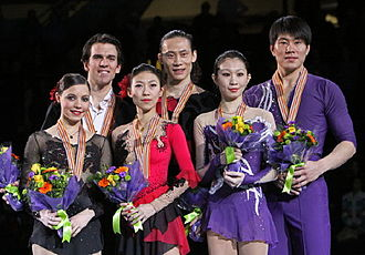 2009 Four Continents Figure Skating Championships - The pairs' podium. From left: Jessica Dubé / Bryce Davison (2nd), Pang Qing / Tong Jian (1st), Zhang Dan / Zhang Hao (3rd).
