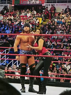 Katarina Waters - Lea along her on-screen brother Paul Burchill during a WWE Raw event in 2008.