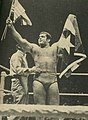 Pedro Morales holds the American and Puerto Rican flags - Inside Wrestling Magazine - November 1972 (cropped).jpg