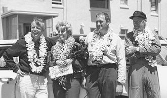 Ann Pellegreno - Ann Pellegreno at Oakland Airport upon the return of the world flight on July 7, 1967. L to R: William Polhemus (navigator), Ann Pellegreno, Leo Koepke (aircraft owner and mechanic) and William Payne (copilot)