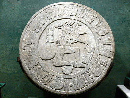 Ballcourt marker, from the Maya site of Chinkultic, dated to 591. The ball itself displays the finely incised portrait of a young deity. Pelotaspieler 1.jpg