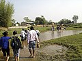 People while crossing river(Koshi Basin) Program (13998847131).jpg