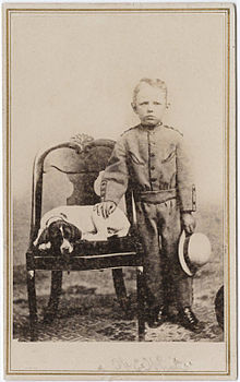 Photograph of a young boy and a dog.jpg